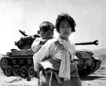 girl carries brother Corea war